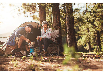 Couple enjoying breakfast at their campsite
